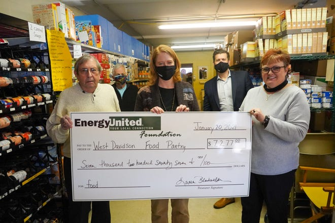 West Davidson Food Pantry and Clothing Closet is one of three local food pantries to receive a grant from the EnergyUnited Foundation. Pictured are Edgar Cartner (front row, from left), vice president of EnergyUnited Board of Directors; Debra Citta, EnergyUnited Foundation administrator; Wendy Marion, director of West Davidson Food Pantry; Dr. Max Walser (back row, from left) president of the EnergyUnited Board of Directors; and Thomas Golden, CEO of  EnergyUnited.