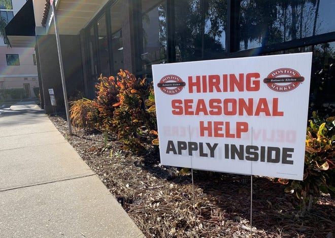 A hiring sign can be seen in front of the Boston Market restaurant on Dunlawton Avenue in Port Orange on Jan. 18, 2021.