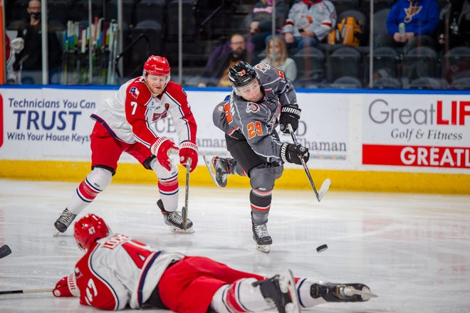 Kansas City Mavericks forward Giorgio Estephan (29) gets past Allen Americans defensemen Kayle Doetzel (7) and Will Lochead (47) for a shot on goal in Saturday's game at Cable Dahmer Arena. The Mavericks, despite outshooting the Americans 37-24, lost 2-1.