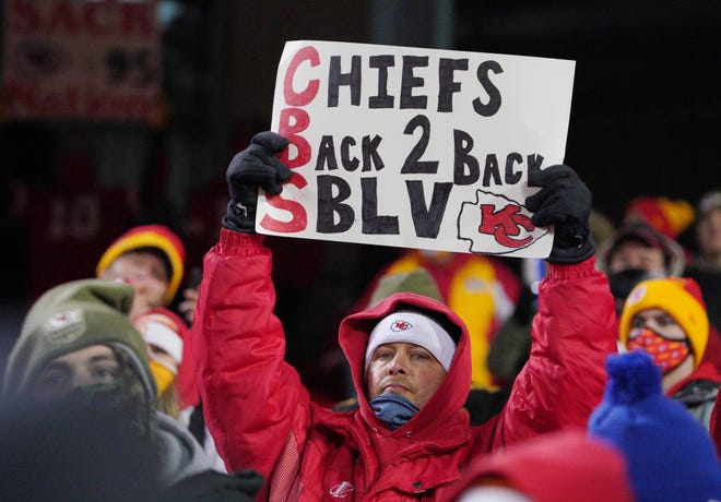 Kansas City Chiefs fans hold up a sign during the fourth quarter in the AFC Championship Game against the Buffalo Bills on Sunday at Arrowhead Stadium in Kansas City, Mo.