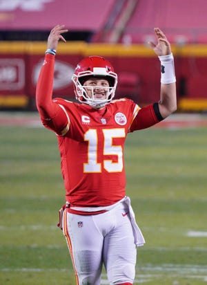 Kansas City Chiefs quarterback Patrick Mahomes (15) celebrates in the fourth quarter against the Buffalo Bills in the AFC Championship Game at Arrowhead Stadium.