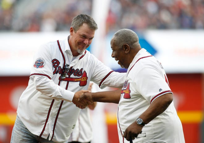 Atlanta Braves former third baseman Chipper Jones (left) shakes hands with Hank Aaron prior to the first MLB game at SunTrust Park on April 14, 2017. [Brett Davis-USA TODAY Sports]