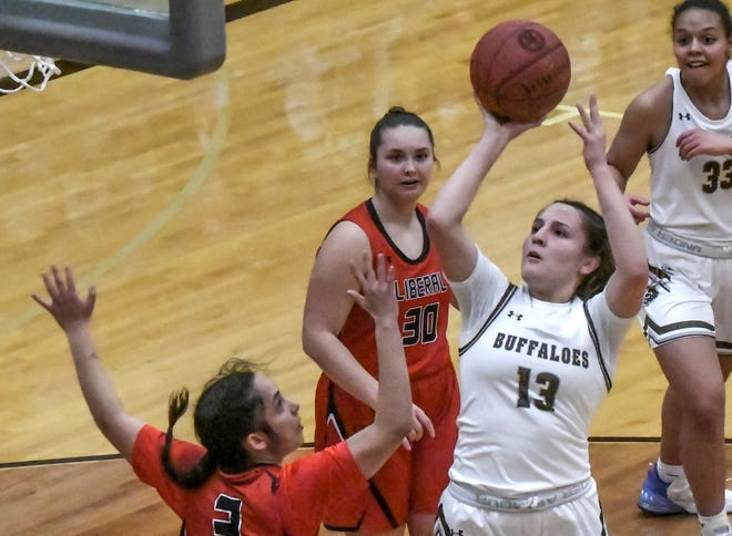 Garden City High School's Amaya Gallegos gos up for a shot in the lan against Liberal on Jan. 12 at GCHS.  Gallegos scored 19 points in the Buffaloes' win Saturday in the championship game of the Orange and Black tournament at Colby.