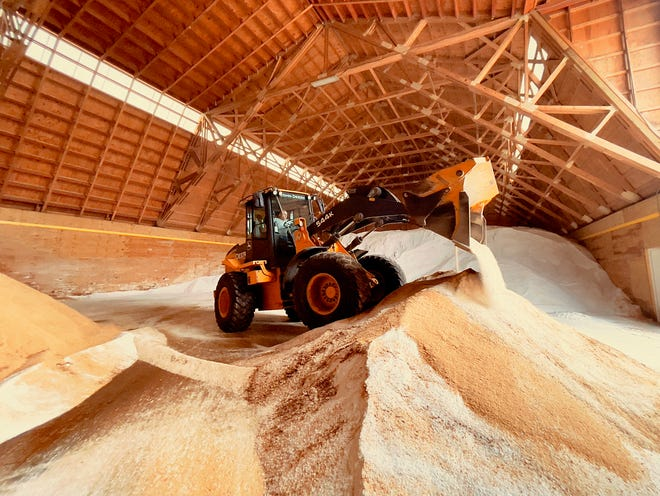 City of Galesburg employee Steve Erickson uses a tractor to mix salt with an ice treatment chemical inside the city's salt storage barn on Monday, Jan. 25, 2021. The National Weather Service in Lincoln has issued a Winter Storm Warning for Galesburg and the surrounding area from noon Monday to noon Tuesday.