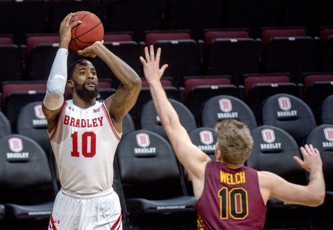 Bradley's Elijah Childs (10) shoots over Loyola's Tom Welch in the second half Sunday, Jan. 24, 2021 at Carver Arena in Peoria.
