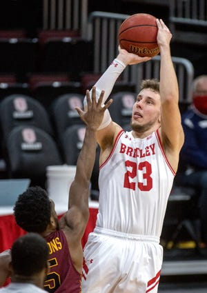 Bradley's Ville Tahvanainen (23) shoots over Loyola's Keith Clemons in the second half Sunday, Jan. 24, 2021 at Carver Arena in Peoria.