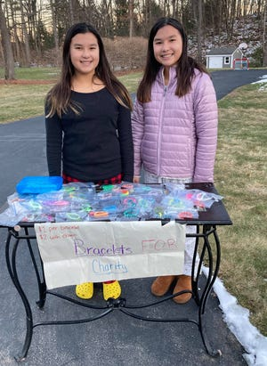 Haley and Natalie Woodbury, 11, made bracelets and donated the proceeds from their sale to St. Jude Children's Research Hospital.