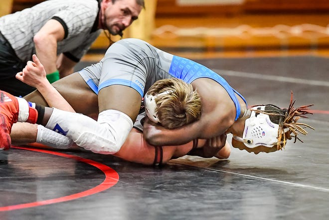 Jadan Abongo of the Brookfield High School wrestling Bulldogs, seen in action during a Jan. 14 dual match against at Chillicothe, earned second place in the 145-pounds division of the Gary Haag Invitational Tournament at Brookfield Saturday, Jan. 23.
