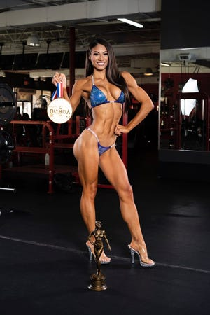Janet Layug, of Lakeland, won the 2020 Olympia Bikini title in Orlando in December.