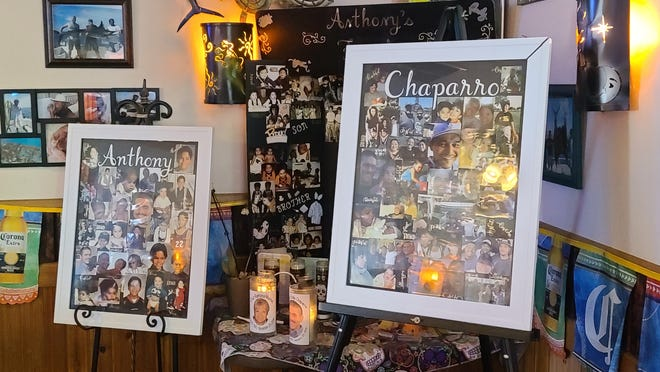 """A collection of family photos of the late Anthony Chaparro and his family is on display in a corner of their family restaurant, Mexico City.  Robert Chaparro, Jr., said he's had people approach him around town to give their condolences and to check in on how things are going.  """"But that's what makes my heart sing,"""" said Chaparro. """"There's so many people that do care, still."""""""