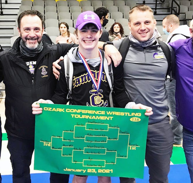 Camdenton's Grant Garrett with his wrestling coaches after winning an Ozark Conference title at 138 pounds on January 23 at Parkview High School. It was Garrett's third conference title and he remains unbeaten on the season at 41-0.