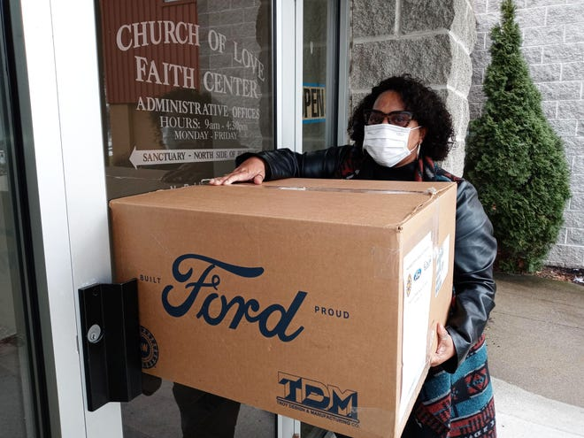 Henderson Ford delivers face masks to the Church of Love Faith Center on Exchange Street.