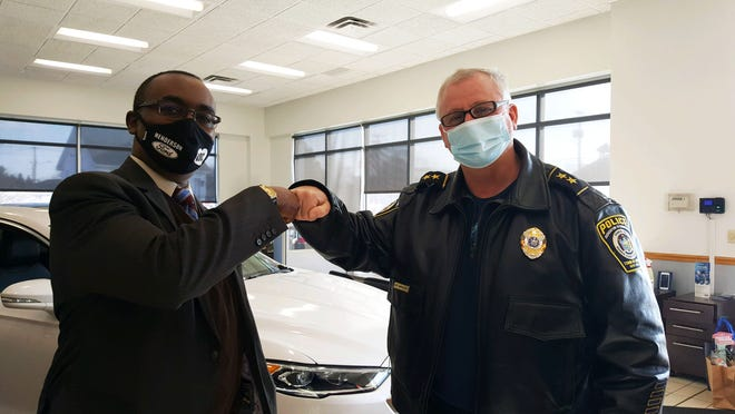 Henderson Ford in Webster provides 2,280 masks to the Gates Police Department. Pictured, from, left are President Randy Henderson and police Chief James VanBrederode.