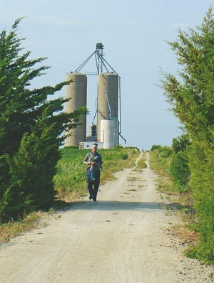 A runner runs on the Meadowlark Trail, a trail between McPherson and Lindsborg that has finally enough funds available to be completed.