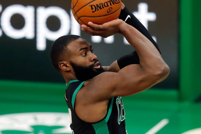 Celtics guard/forward Jaylen Brown shoots during the second half of Boston's 141-103 win over the Cavaliers Sunday night.