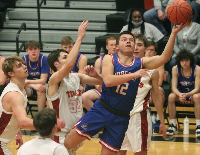 Moberly senior guard Dominic Stoneking finds a seam  in the middle of the lane between four Kirksville players as he attacks the rim in trying to score Saturday. Stoneking and the Spartans suffered an 85-53 loss to Kirksville in the boys championship game of the Macon Tournament.