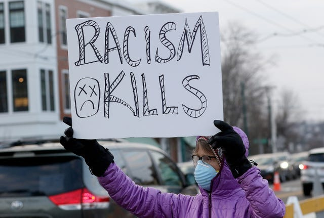 Eleanor Hobbs, of Lexington, holds a sign along Trapelo Road in Belmont before the start of a rally mourning and honoring Henry Tapia, Jan. 21, 2021. Dean Kapsalis, of Hudson, has been charged with murder in Tapia's death after a road rage incident two days before.   [Wicked Local Staff / Ann Ringwood]