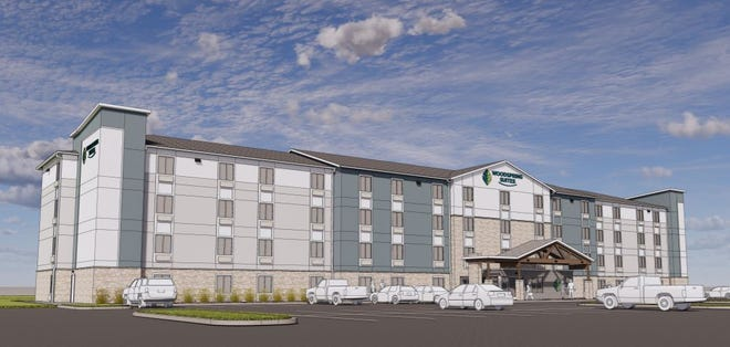 An artist's rendering shows a WoodSpring Suites hotel like the one being proposed for U.S. Highway 98 in Miramar Beach. Walton County commissioners will consider the project on Thursday.