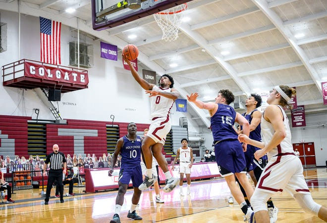 Colgate men's basketball guard Nelly Cummings goes up for a basket Jan. 16 against Holy Cross. This weekend's men's and women's basketball games were postponed because of positive COVID-19 tests with opponents Bucknell.