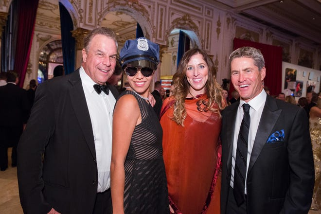Palm Beach billionaire Jeff Greene and wife Mei Sze Greene, at left, posed with Tampa Bay Buccaneers co-owner and Palm Beach resident Darcie Glazer Kassewitz and her husband, Joel Kassewitz, at a 2018 charity event in Palm Beach.