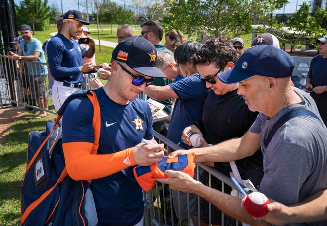 Houston Astros Alex Bregman, right, and Carlos Corea, left, sign autographs for fans during spring training at the Ballpark of The Palm Beaches last year. [GREG LOVETT/palmbeachpost.com]