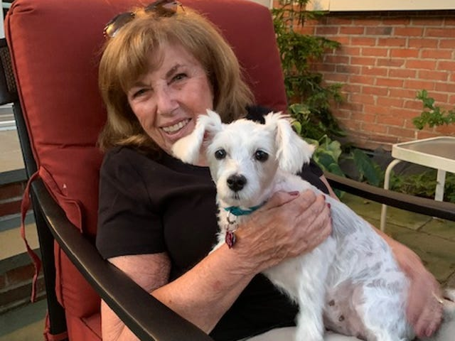 """Barbara Kirsh, a seasonal resident of Delray Beach, poses with her grandpup that helped inspire her contest-winning short story """"Hot Dog."""""""