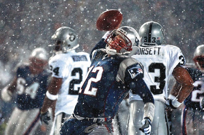 In what became known as the Snow Bowl, Patriots quarterback Tom Brady spikes the ball after scoring a fourth-quarter touchdown against the Raiders in the AFC Divisional Playoff game  in Foxboro on Jan. 19, 2002.
