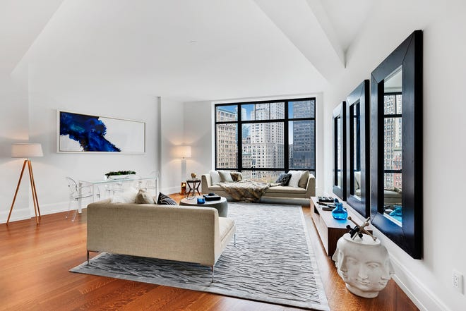 An oversized rug adds a sense of spaciousness in this loft-style space.