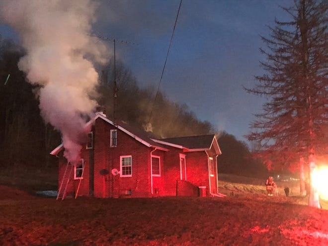 A Carroll County man has been charged with aggravated murder and aggravated arson in the death of a fellow group home residentwhom investigators say was set on fire. Firefighters can be seen battling the Minerva area blaze.