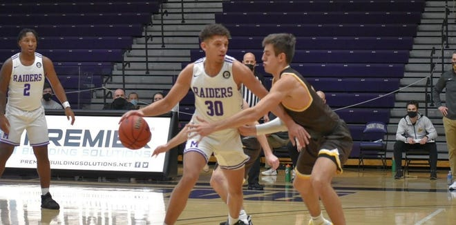 Mount Union's Braedon Poole (30) is the first Ohio Athletic Conference Men's Basketball Player of the Week. He averaged 17 points and 9 rebounds in the Purple Raiders' weekend sweep of Baldwin Wallace. (Emily Swisher / University of Mount Union Athletics)