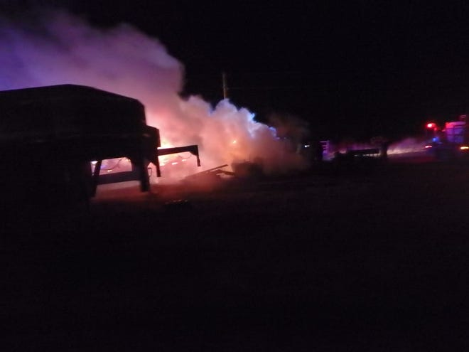 A fire destroyed two sheds in Saline County Friday evening.