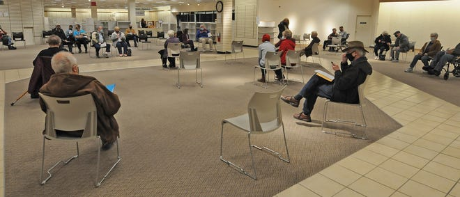 Community members 65 and older wait after getting their COVID-19 vaccinations at the former J.C. Penney location in the Salina Central Mall on Monday. Last week, in less than 30 minutes, 900 people secured appointments for their first COVID-19 vaccine.