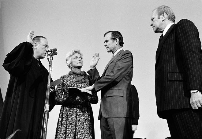 George Bush is sworn in as new director of the Central Intelligence Agency by Supreme Court Associate Justice Potter Stewart, left, as Mrs. Barbara Bush and President Gerald Ford, at right, look on at CIA headquarters Jan. 30, 1976, in Langley, Va. Bush succeeds William Colby who retired.