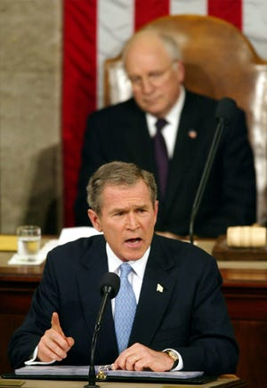 """President George W. Bush gives his State of the Union address on Capitol Hill on Jan. 29, 2002, in Washington, during which he grouped Iran, Iraq and North Korea together as the West's most dangerous foe, and called them an """"axis of evil."""""""
