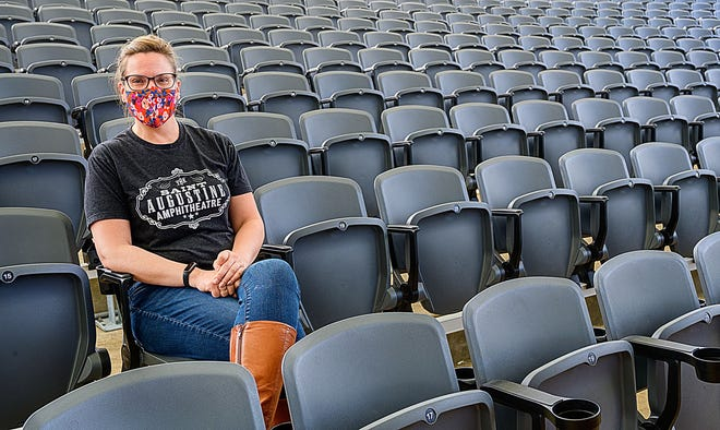Dianya Markovits, public relations & partnerships manager for the St. Augustine Amphitheatre, sits in new seats installed in the venue on Monday, Jan. 25, 2021. The new seats can be individually locked closed to allow for social distancing at events because of the COVID-19 pandemic.