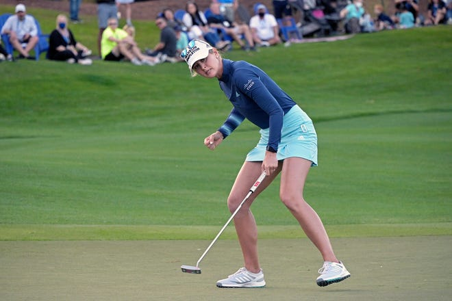 Jessica Korda celebrates as she sinks a putt on the 18th green during a playoff against Danielle Kang to win the final round of the Tournament of Champions LPGA golf tournament, Sunday, Jan. 24, 2021, in Lake Buena Vista, Fla. (AP Photo/Phelan M. Ebenhack)