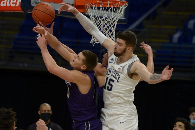 Penn State's Trent Buttrick (15) and Northwestern's Miller Kopp (10) battle for a rebound during the first half of an NCAA college basketball game, Saturday, Jan 23, 2021, in State College, Pa. (AP Photo/Gary M. Baranec)