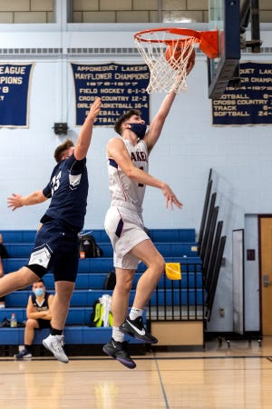 Patrick White gets some air and a successful layup off of a steal in the second quarter.