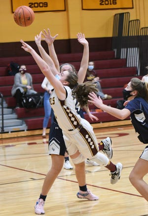 Case's Abby Sirois gets by Somerset Berkley's Abby Gajewski for a basket when the two rival teams squared off back on Jan. 15. SB took the win on the night, 43-36.