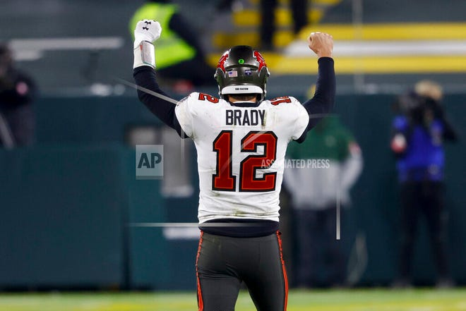 Tampa Bay Buccaneers quarterback Tom Brady reacts after winning the NFC championship NFL football game against the Green Bay Packers in Green Bay, Wis., Sunday, Jan. 24, 2021. The Buccaneers defeated the Packers 31-26 to advance to the Super Bowl.