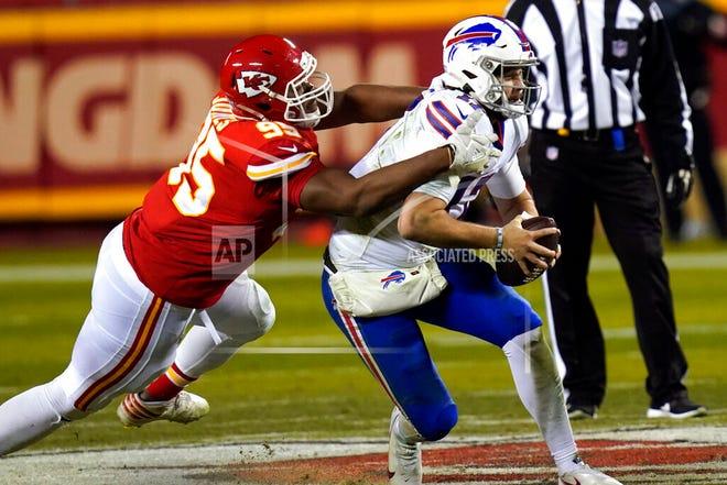 Kansas City Chiefs defensive tackle Chris Jones, left, tackles Buffalo Bills quarterback Josh Allen during the second half of the AFC championship NFL football game, Sunday, Jan. 24, 2021, in Kansas City, Mo.