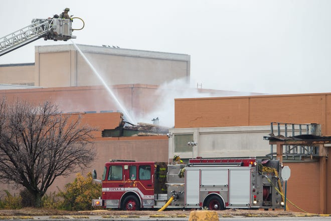 Topeka firefighters on Dec. 29 battled an intentionally set blaze that caused an estimated $100,000 in damage at the former White Lakes Mall, 3600 S.W. Topeka Blvd.