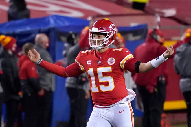 Kansas City Chiefs quarterback Patrick Mahomes celebrates after throwing a 5-yard touchdown pass to tight end Travis Kelce during the second half of the AFC championship NFL football game against the Buffalo Bills on Sunday in Kansas City, Mo.