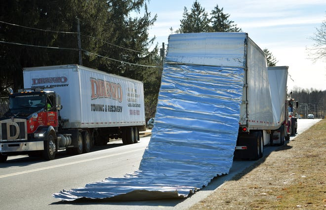 A tractor-trailer driver was cited after hitting a railroad overpass on Monday. The Wyoming driver continued about a half-mile before pulling over near Hope Cemetery.