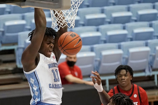North Carolina forward Day'Ron Sharpe (11) dunks against North Carolina State during the first half of an NCAA college basketball game in Chapel Hill, N.C., Saturday, Jan. 23, 2021. (AP Photo/Gerry Broome)