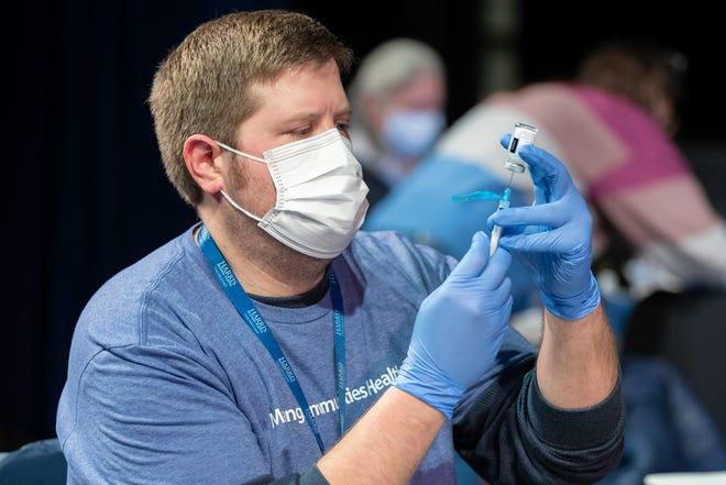 Harris Regional Hospital pharmacist Will Layfield prepares vaccines on Jan. 22 in Jackson County.
