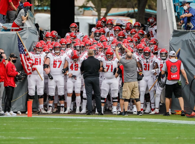 Jan 2, 2021; Jacksonville, FL, USA; North Carolina State Wolfpack ready to take the field before a game against the Kentucky Wildcats at TIAA Bank Field. Mandatory Credit: Mike Watters-USA TODAY Sports