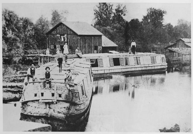 This photo showsBill Nye, his boat Reform and several of his children. A son, Pearl Nye, later would travel the Ohio and Erie Canal in his boat Rosalie.