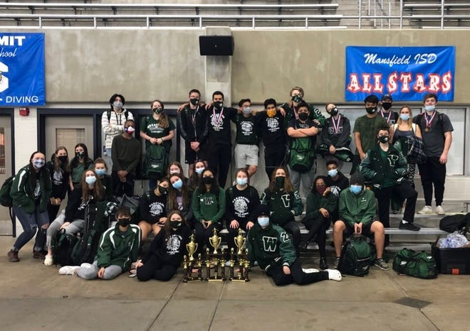 Waxahachie swim team members pose with their trophies and medals at the District 6-6A championship meet at the Debbie Weems Mansfield ISD Natatorium. The Indians and Lady Indians placed second in each division and qualified a total of 16 regional entries.