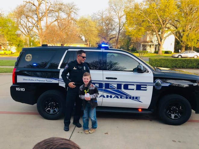 Waxahachie Police Officer Austin Rollins shows off his patrol unit to a lucky second-grade student at Marvin Elementary in March 2019. Rollins was commended by Fire Chief Ricky Boyd during last week's Waxahachie City Council meeting for his life-saving actions during a major motor vehicle incident on Jan. 9.